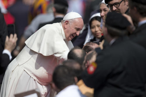 Pope Francis blesses sick people as he leaves St.Peter's Square, at the Vatican at the end of his weekly general audience, Wednesday, March 19, 2014. (AP Photo/Andrew Medichini)