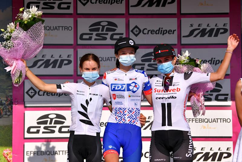 MOTTAMONTECORVINO ITALY SEPTEMBER 19 Podium Niamh FisherBlack of New Zealand and Team Paule Ka Evita Muzic of France and Team FDJ Nouvelle Aquitaine Futuroscope Juliette Labous of France and Team Sunweb Celebration Mask Covid safety measures Flowers during the 31st Giro dItalia Internazionale Femminile 2020 Stage 9 a 1099km stage from Motta Montecorvino to Motta Montecorvino 645m GiroRosaIccrea GiroRosa on September 19 2020 in Motta Montecorvino Italy Photo by Luc ClaessenGetty Images
