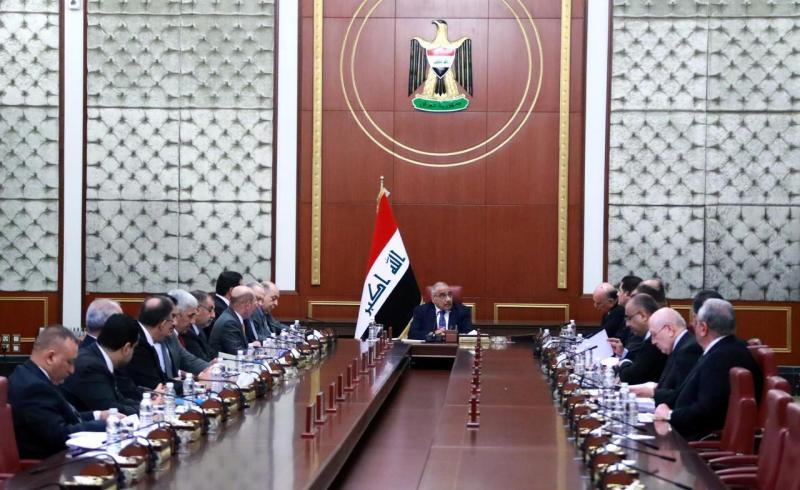 In a photo released by the Iraqi Prime Minister Media Office, Iraqi acting Prime Minister Adil Abdul-Mahdi, center, heads a cabinet meeting at the prime minister's office, in Baghdad, Iraq, Tuesday, Jan. 7, 2020. (Iraqi Prime Minister Media Office, via AP)