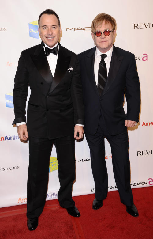 David Furnish, left, and Elton John attend the Elton John AIDS Foundation 10th Annual Enduring Vision Benefit, on Wednesday, Oct. 26, 2011, in New York. (AP Photo/Peter Kramer)