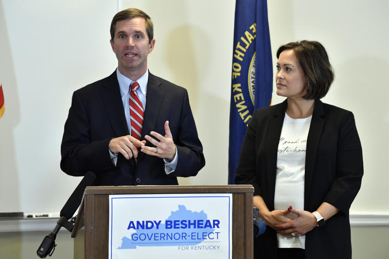 """FILE - In this Nov. 14, 2019, file photo, Kentucky Gov.-elect Andy Beshear, left, with Lt. Gov.-elect Jacqueline Coleman, speaks with reporters following the concession of incumbent Gov. Matt Bevin in Frankfort, Ky. It's a role that seems scripted for Coleman, as an educator transitioning to the job as a """"full partner"""" in a Democratic administration that vows to make public education a top priority. (AP Photo/Timothy D. Easley, File)"""