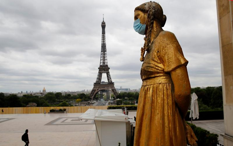 There are concerns in France that people are failing to maintain social distancing and wear masks - AP/Christophe En