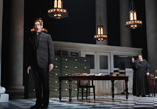 """In this Jan. 23, 2013 photo provided by the Minnesota Opera, Matthew Worth as Father Brendan Flynn, a parish priest and Christine Brewer as Sister Aloysius Beauvier, the school principal, perform during a dress rehearsal for the Jan. 26 world premiere of """"Doubt"""" at the Minnesota Opera Center in Minneapolis. (AP Photo/Minnesota Opera, Michal Daniel)"""