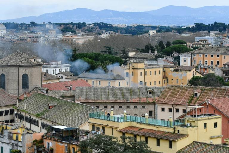 Smoke billows from a rooftop of the Regina Coeli prison in Rome
