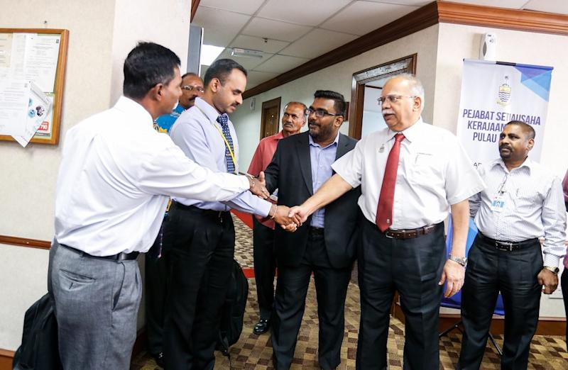 Deputy Chief Minister II P. Ramasamy (2nd right, red tie) and Bagan Dalam assemblymen M. Satees (middle, grey jacket) are seen after giving their statements to Bukit Aman officers in George Town September 11, 2019. — Picture by Sayuti Zainudin