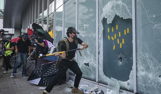 Protesters break windows in an attempt to storm the Legislative Council Complex in Tamar in July 2019. Photo: Winson Wong