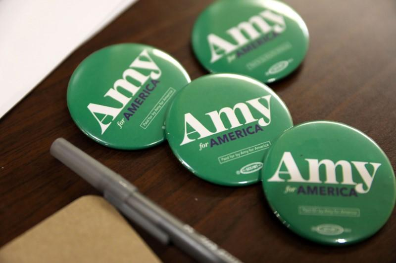 Buttons for Democratic U.S. presidential candidate Amy Klobuchar at an event in Fort Dodge