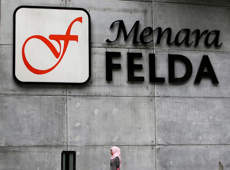 Felda intends to reclaim some 350,000 hectares of land that it has leased to FGV Holdings Berhad to shore up its financial position. — Reuters pic