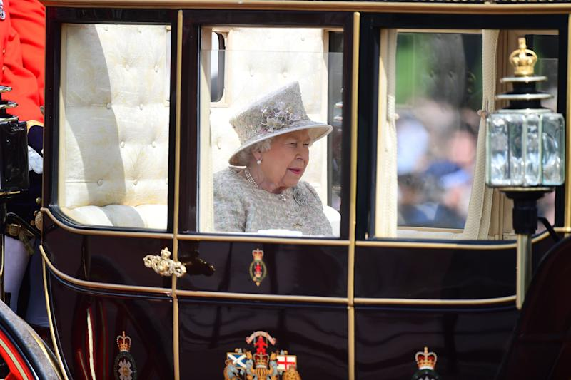 Queen Elizabeth II makes her way from Buckingham Palace to Horse Guards Parade, in London, ahead of the Trooping the Colour ceremony, as she celebrates her official birthday. (Photo by Victoria Jones/PA Images via Getty Images)