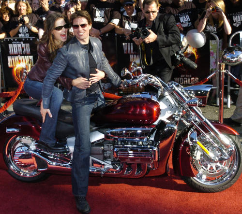 "FILE - In this June 27, 2005 file photo, Tom Cruise, star of the new film ""War of the Worlds,"" arrives with his fiancee Katie Holmes on motorcycle for a screening of the film at Grauman's Chinese Theatre in Los Angeles. Cruise and Homes are calling it quits after five years of marriage. Holmes' attorney Jonathan Wolfe said Friday June 29, 2012 that the couple is divorcing, but called it a private matter for the family. (AP Photo/Chris Pizzello, File)"
