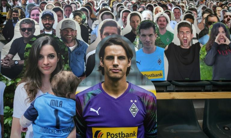 Gladbach goalkeeper Yann Sommer is pictured next to his partner Alina (L) among the cardboard cut-out supporters for Saturday's game at home to Leverkusen
