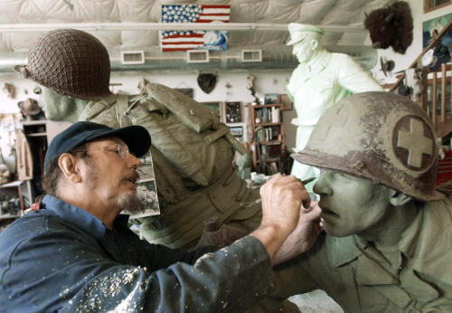 In this June 2002 photo Kansas sculptor Jim Brothers works in Lawrence, Kan., on sculptures of a World War II medic following a soldier onto the shores of France on D-Day, that are destined for the National D-Day Memorial in Bedford, Va. Brothers, whose works are part of historical monuments around the country, died Tuesday, Aug. 20, 2013, at his home in Lawrence where he had been in hospice care, according to a funeral director at Warren McElwain Mortuary. He was 72. (AP Photo/Lawrence Journal World, Mike Yoder)