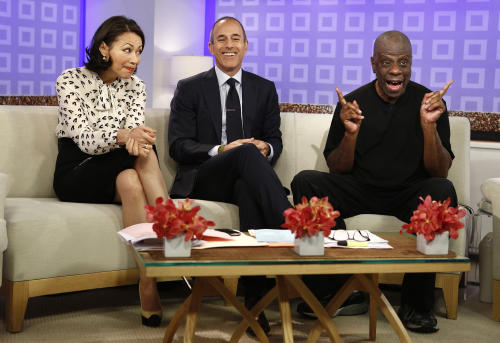 "This image released by NBC shows co-hosts Ann Curry, left, and Matt Lauer, center, with actor Jimmie Walker from the 1970s series ""Good Times,"" on the ""Today"" show, Tuesday, June 26, 2012 in New York. Walker was promoting his memoir ""Dynomite!: Good Times, Bad Times, Our Times."" Curry got thumped by a ""Today"" TV camera Tuesday, during a crowd-panning sequence out on Rockefeller Plaza. Curry's face collided with the camera lens on live TV. (AP Photo/NBC, Peter Kramer)"