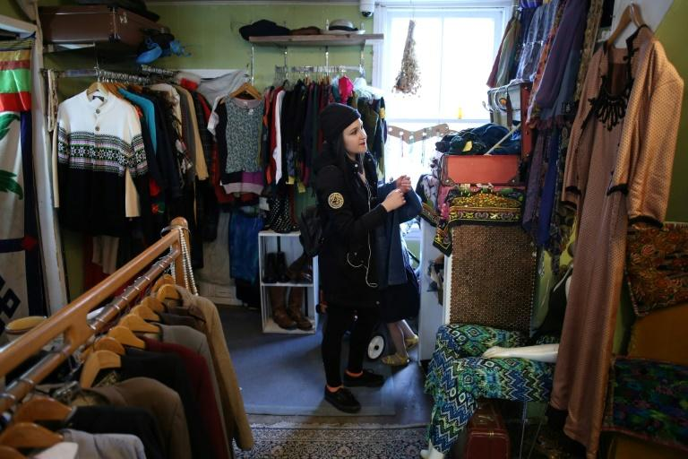 A shopper browses at a vintage clothing store in Ottawa,Ontario, as stores reopen after two months of lockdown