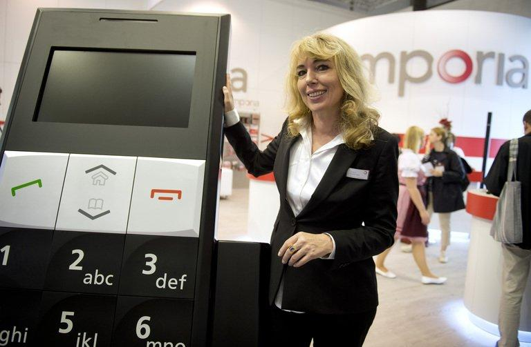 Eveline Pupeter of Emporia at the IFA trade fair in Berlin last August. A new black and silver flip phone for seniors, Emporia Connect, comes with a system called Emporia Me, allowing a child or grandchild to check the device's location, battery status, or even turn up the volume on the phone to make sure the elderly owner can hear it