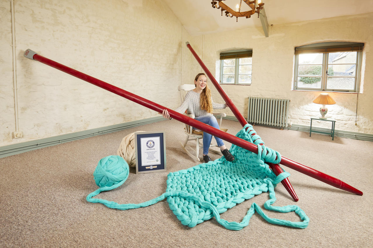 "<p>Betsy Bond is in the book for the record for the largest knitting needles. Artist Betsy, 31, from Wiltshire, created the 4.4m needles herself as part of an art exhibition. She said: ""Everybody has potential if you just keep striving and pushing forward. Give it a go, what's the worst that can happen?""<br />[Photo: Paul Michael Hughes/Guinness World Records] </p>"