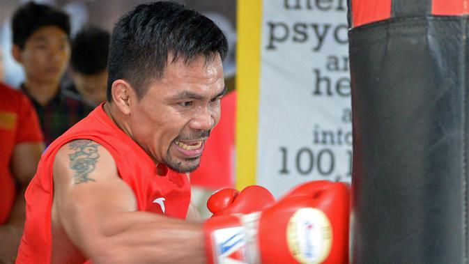 Petinju asal Filipina, Manny Pacquiao. (AFP Photo/Ted Aljibe)