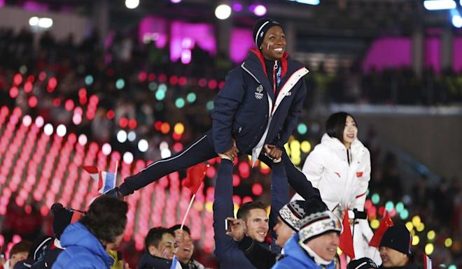 French and Chinese athletes at the 2018 closing ceremony. Photo: AP
