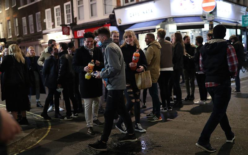 People on the streets of Soho, central London, after the pub and restaurant curfew on Saturday night - Yui Mok/PA