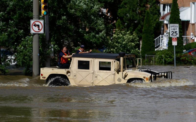 Philadelphia firefighters drive through a flooded neighbourhood on Tuesday - AP Photo/Matt Slocum