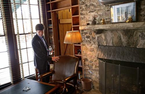 Documentary filmmaker Ken Burns, right, touches the chair where former President Franklin D. Roosevelt was sitting for a portrait when he died April 12, 1945 in his Georgia home, Saturday, Nov. 2, 2013, in Warm Springs, Ga. Burns along with several members of the Roosevelt family toured the home known as the Little White House Saturday used by Roosevelt as Burns previewed parts of his 14-hour film on the Roosevelt's. (AP Photo/David Goldman)