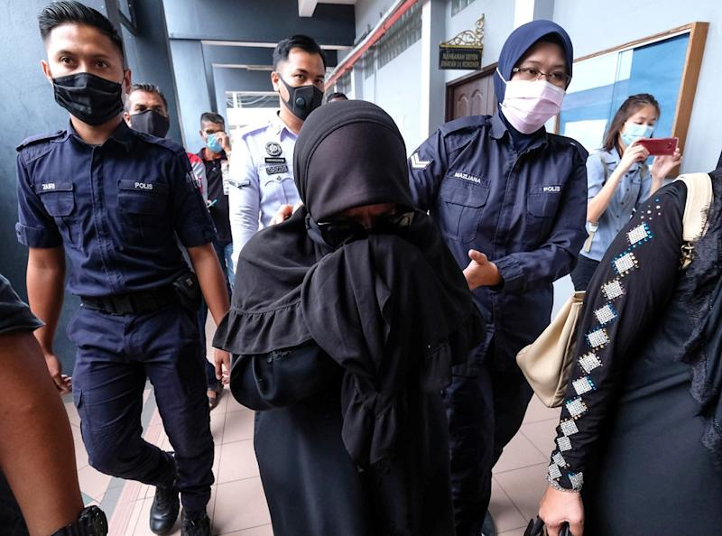 Nur Emah Mohamad Hashim, dubbed the 'pink wristband woman' on social media, is seen at the Magistrate's Court in Ipoh August 14, 2020. — Bernama pic