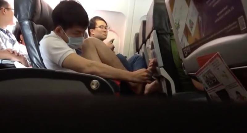 Air Asia passenger picks feet on flight
