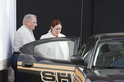 Shannon Richardson is placed into a Titus County Sheriff's car after an initial appearance Friday, June 7, 2013 at the federal building Texarkana, Texas. The FBI says Shannon Richardson admitted sending ricin-tainted letters to President Barack Obama and New York City Mayor Michael Bloomberg, but only after trying to pin it on her husband. ((AP Photo/The Texarkana Gazette, Curt Youngblood) MANDATORY CREDIT
