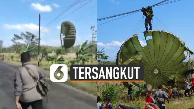 VIDEO: Kompak, Masyarakat Bantu Penerjun Payung Anggota TNI yang Tersangkut Kabel