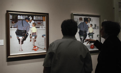 "FILE - In this May 25, 2004 file photo, visitors at The Norman Rockwell Museum view the 1958 painting ""The Runaway,"" in one of the galleries in Stockbridge, Mass. Retired Massachusetts state trooper Staff Sgt. Richard Clemens, who was the model for the police officer in the painting, died Sunday, May 6, 2012. He was 83. (AP Photo/Nancy Palmieri, File)"