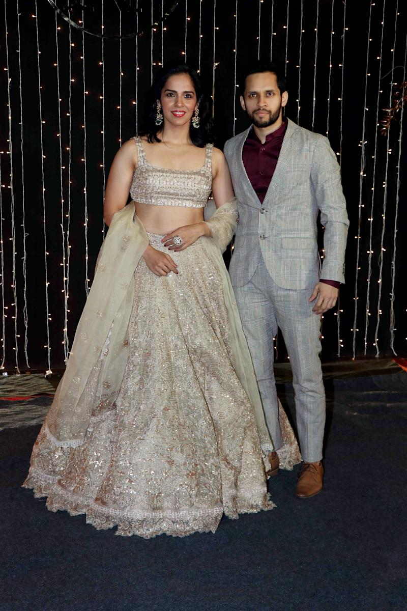 MUMBAI, INDIA - 2018/12/20: India's star badminton player Saina Nehwal (L) with husband Parupalli Kashyap (R) pose as they arrive to attend Priyanka-Nicks wedding reception at hotel Taj Lands End in Mumbai. The newly-married couple, Priyanka Chopra and Nick Jonas held a reception party for their Bollywood folks at hotel Taj Lands End in Mumbai. (Photo by Azhar Khan/SOPA Images/LightRocket via Getty Images)