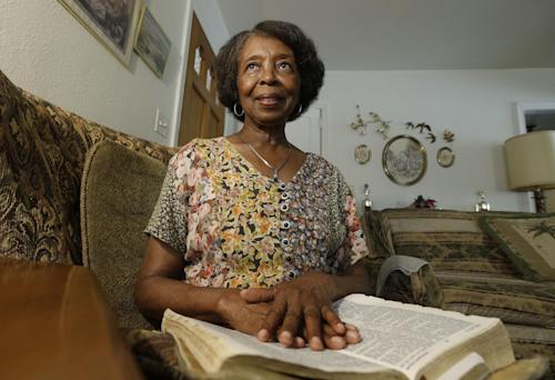 "Henrietta Tripp holds her bible at her home in Birmingham, Ala., Friday, Sept. 6, 2013. Tripp was walking to a service at her church, Zion Hill Missionary Baptist, the Sunday when the 16th Street Baptist Church bombing occurred five decades ago. ""Why so much so hatred?"" she thought to herself. ""Why so much anger?"" (AP Photo/Dave Martin)"