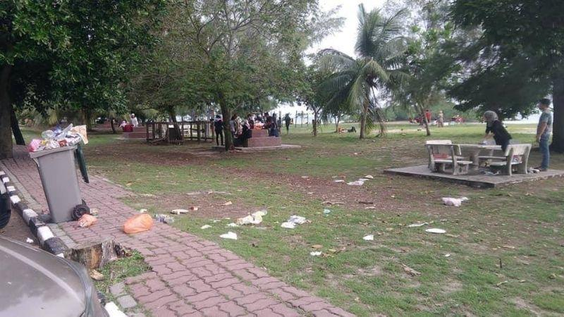 Scattered rubbish is seen on the ground at the popular beach town of Port Dickson. — Picture via Facebook