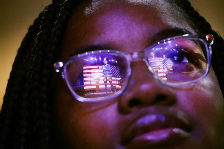 Democratic presidential candidate Elizabeth Warren is reflected in a student's glasses as she speaks at South Carolina State University