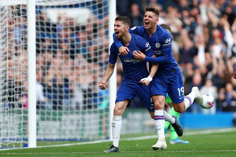 Jorginho (left) celebrates with Chelsea teammate Mason Mount after scoring what turned out to the game-winning goal in Saturday's victory against Brighton. (Dan Istitene/Getty)