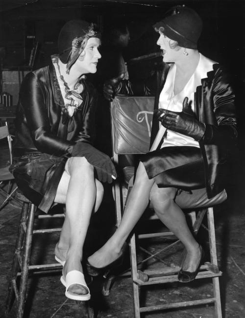 "FILE In this undated file photo, under the 1920's costumes and makeup of this pair of animated females are two of Hollywood's best known he-men, Jack Lemmon, left, and Tony Curtis. They masquerade as women in an all-girl orchestra to escape gangsters hunting them in Billy Wilder's 1959 film, ""Some Like It Hot,"" in which they co-star with Marilyn Monroe. (AP Photo, File)"