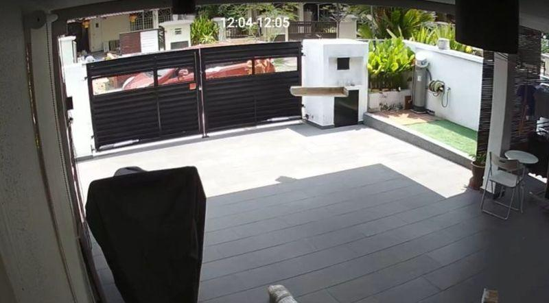 A video recording shows a delivery person from Shopee tossing three items into a customer's car porch. — Picture via SoyaCincau