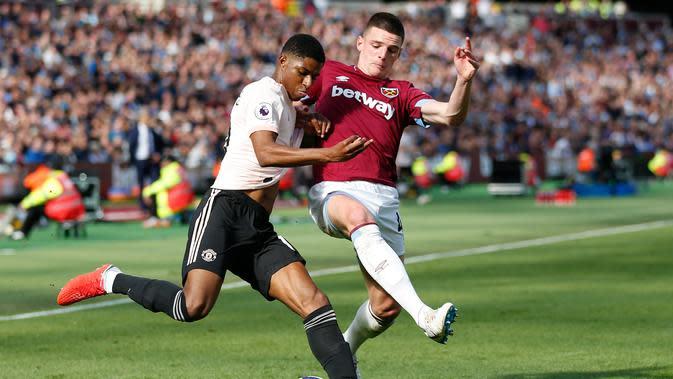 Declan Rice (kanan) pemain muda yang sedang diincar Chelsea (AFP)