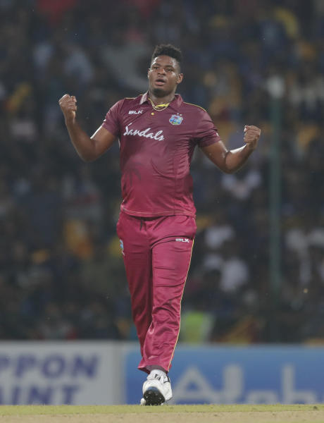 West Indies' bowler Oshane Thomas celebrates the dismissal of Sri Lanka's Dasun Shanaka during their first Twenty20 cricket match in Pallekele, Sri Lanka, Wednesday, March 4, 2020. (AP Photo/Eranga Jayawardena)