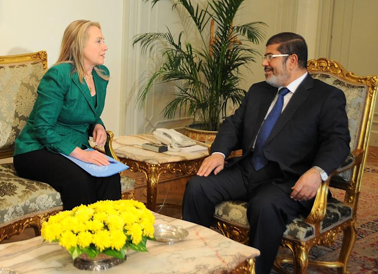 "In this photo released by the Egyptian Presidency, U.S. Secretary of State Hillary Rodham Clinton, left, meets with Egyptian President Mohammed Morsi, right, in Cairo, Egypt, Wednesday, Nov. 21, 2012. Secretary of State Hillary Rodham Clinton has arrived in Cairo in her diplomatic push to forge a truce between Israel and Gaza rulers of Hamas. Her visit comes hours after a bomb exploded on an Israeli bus in Tel Aviv, wounding several. Clinton is looking to piece together a deal to end Israel's weeklong offensive in the Gaza Strip. Clinton said the U.S. ""strongly condemns"" today's bus bombing, calling it a ""terrorist attack."" (AP Photo/Egyptian Presidency)"