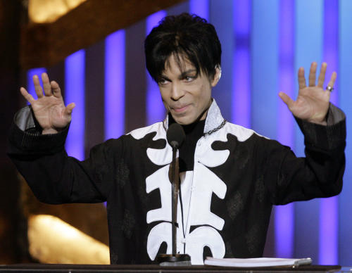 """FILE - In this March 2, 2007 file photo, Prince accepts the award for outstanding male artist at the 38th NAACP Image Awards in Los Angeles. Prince announced Tuesday, Sept. 3, 2013, that he's released a new song, titled """"Breakfast Can Wait."""" The song is being released through his new distribution deal with the independent Kobalt Label Services. He's working on a new album that's set to be titled, """"Plectrum Electrum."""" (AP Photo/Chris Carlson, File)"""