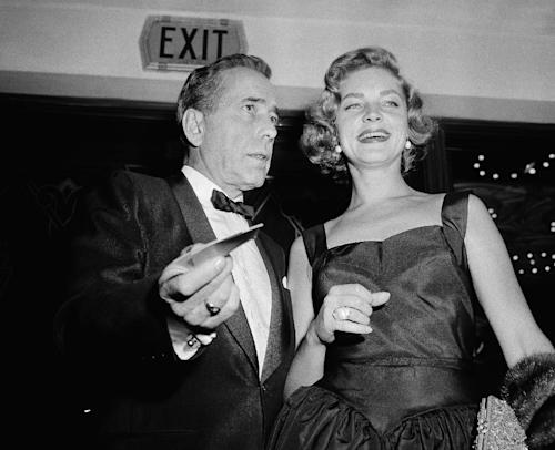"FILE - This Oct. 12, 1955 file photo shows actors Humphrey Bogart, left, and his wife, Lauren Bacall at the premiere of ""The Desperate Hours,"" in Los Angeles. Bacall, the sultry-voiced actress and Humphrey Bogart's partner off and on the screen, died Tuesday, Aug. 12, 2014 in New York. She was 89. (AP Photo/Harold Filan, FIle)"
