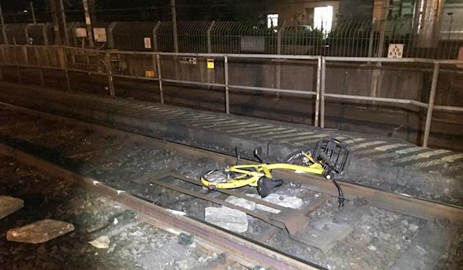 A bike was among the items dumped on the East Rail line between Fanling and Sheung Shui stations. Photo: Handout