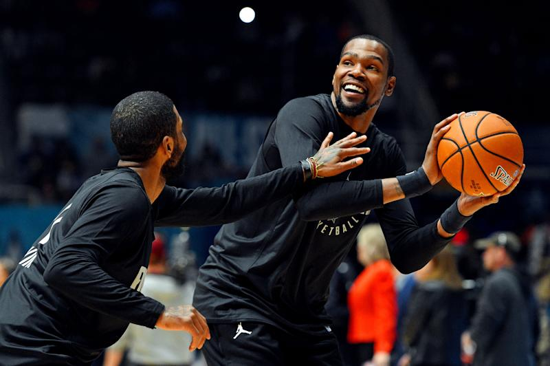 Feb 16, 2019; Charlotte, NC, USA; Team Lebron forward Kevin Durant of the Golden State Warrior (35) handles the ball against Team Lebron guard Kyrie Irving of the Boston Celtics (11) during NBA All-Star Game practice at the Bojangles Coliseum. Mandatory Credit: Bob Donnan-USA TODAY Sports