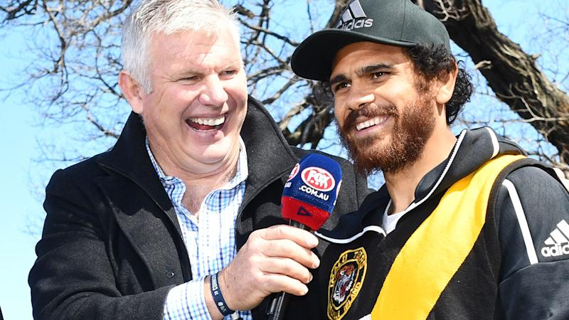 Danny Frawley and Cyril Rioli, pictured here before the AFL grand final in 2018.