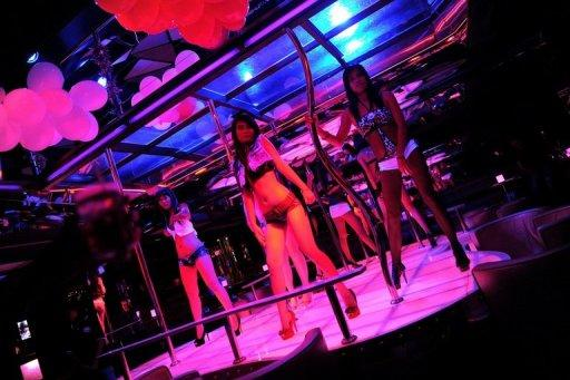 Bangkok's Patpong district is notorious for its raunchy nightlife, where dozens of transgender prostitutes flit among the sprawl of sex shows, pick-up bars and massage parlours