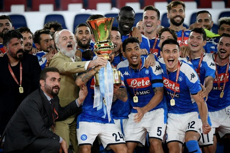 Napoli coach Gennaro Gattuso (L) and club president Aurelio De Laurentiis (3rdL holding trophy) celebrate with players after winning the Italian Cup