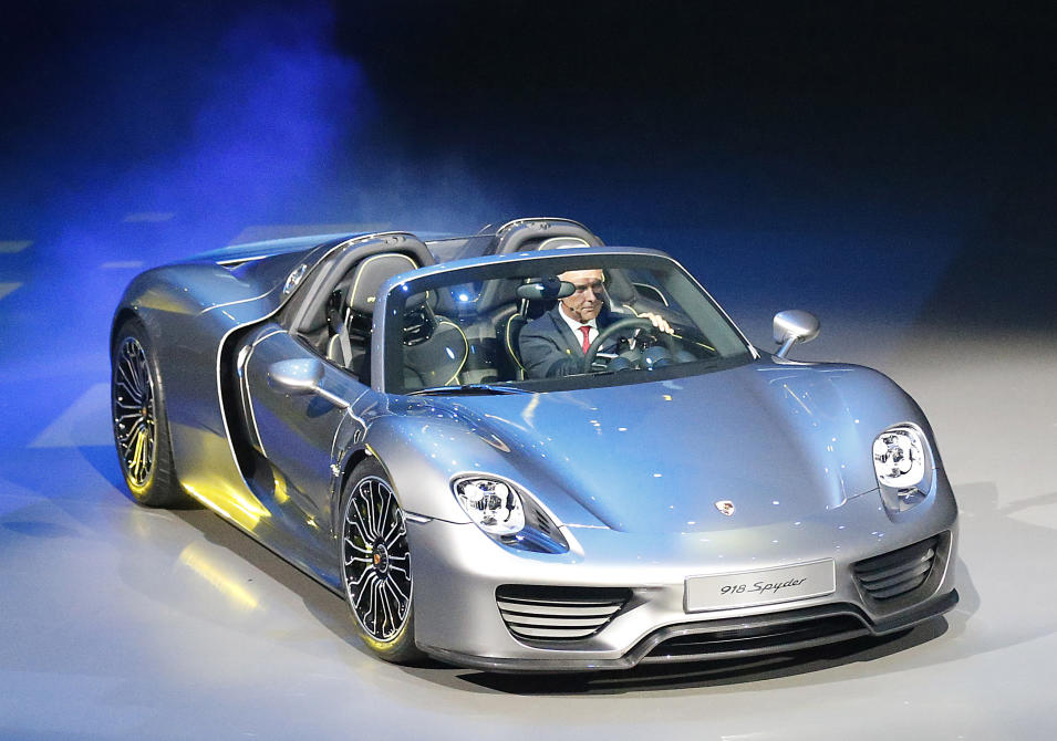 Porsche AG CEO Matthias Mueller steers the new Porsche 918 Spyder during a preview by the Volkswagen Group prior to the 65th Frankfurt Auto Show in Frankfurt, Germany, Monday, Sept. 9, 2013. More than 1,000 exhibitors will show their products to the public from Sept. 12 through Sept. 22, 2013. (AP Photo/Frank Augstein)