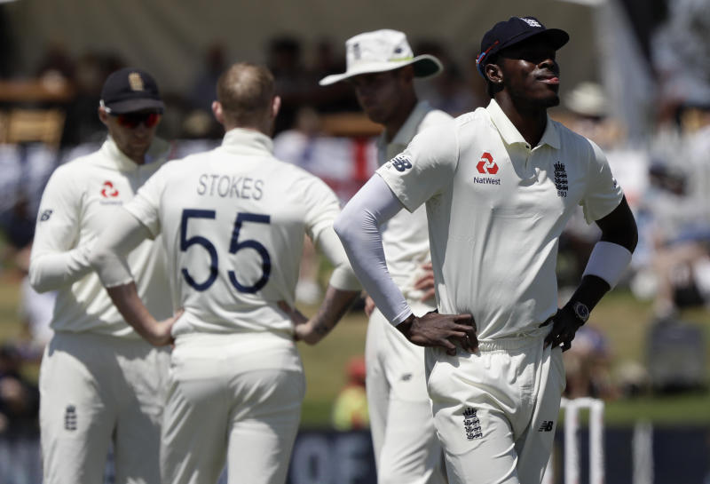 FILE- In this Nov. 24, 2019 file photo, England's Jofra Archer reacts during play on day four of the first cricket test between England and New Zealand at Bay Oval in Mount Maunganui, New Zealand. A New Zealand fan who racially abused Archer during a test match at Bay Oval in November has been banned from domestic and international matches in New Zealand for two years. (AP Photo/Mark Baker)