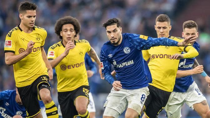 Pertandingan Schalke kontra Borussia Dortmund penanda kembalinya Bundesliga musim ini. (Istimewa)